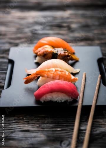 Poster Sushi bar sashimi sushi set with chopsticks and soy