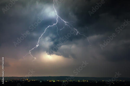 Foto auf Leinwand Onweer Lightnings over city during thunderstorm
