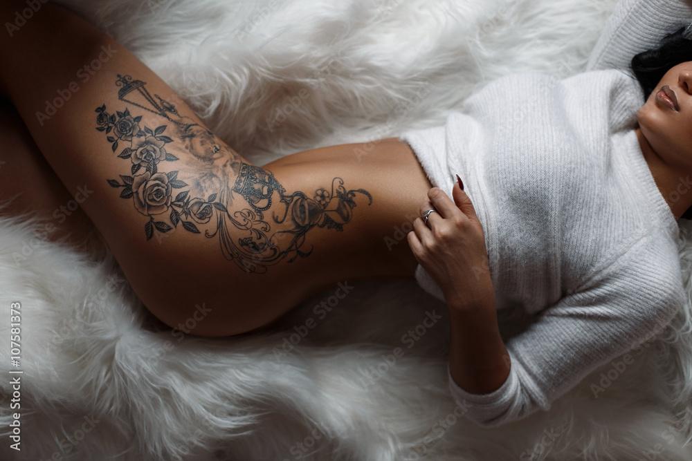 Fototapeta Beautiful female sexy body with a stylish vintage tattoo