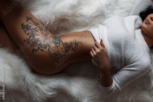 Beautiful female sexy body with a stylish vintage tattoo
