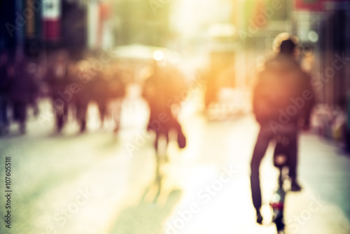 Photo People and cyclist in the street, urban, abstract blurry