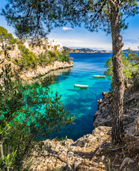 FototapetaMediterranean bay with rowboats at Cala Fornells Majorca Spain