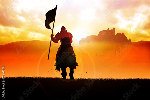 Fotografie, Obraz  Silhouette of a medieval knight on horse carrying a flag