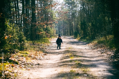Fototapety, obrazy: Caucasian boy playing outdoor