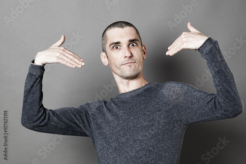 Fotografie, Obraz  self-esteem concept - happy young man with short hair showing or picking himself