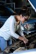 Girl checking car engine