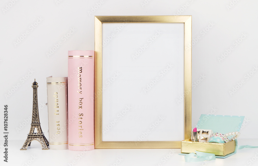 Fototapety, obrazy: gold picture frame with decorations. Mock up for your photo or text Place your work, print art,shabby style, white background,, pastel color book, paris, lipstick, mint and gold accessories