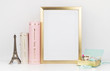 canvas print picture - gold picture frame with decorations. Mock up for your photo or text Place your work, print art,shabby style, white background,, pastel color book, paris, lipstick, mint and gold accessories