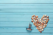 Background with heart made of seashells and decorative sailing b