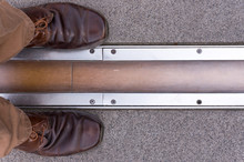 Feet Standing On Opposite Sides Of The Prime Meridian. Greenwich