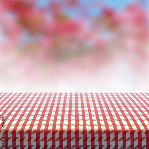 vector picnic table covered with tablecloth on blurred background