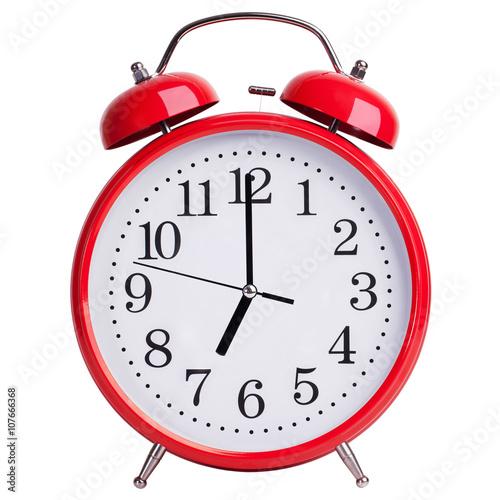 Photo Alarm clock shows exactly seven o'clock