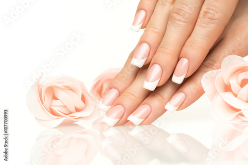 Poster Manicure Woman hands with french manicure close-up