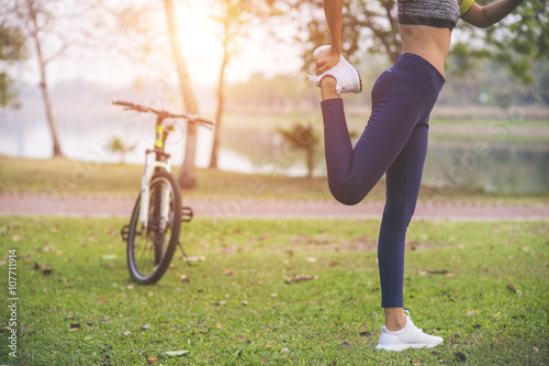 Fotografie, Obraz  young woman, exercise in gardent background