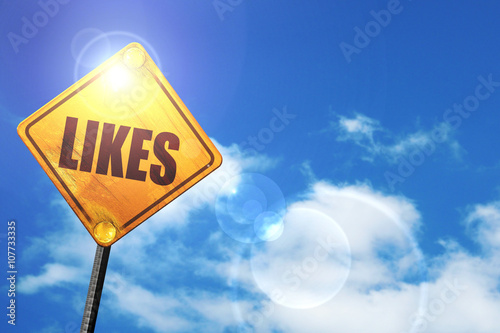 Photo  Yellow road sign with a blue sky and white clouds: likes