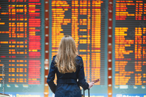 Young female traveler in international airport Fototapeta