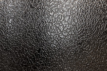 Closeup Of Frosted Glass Texture Background. Black Ice.