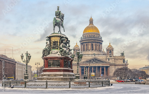 Foto op Plexiglas Artistiek mon. A view of Isaac square with The Monument to Nicholas I and St.Isaac Cathedral at a snowy winter day