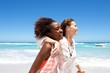 canvas print picture - Smiling young female friends at the beach