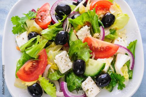 Fotografie, Obraz  Greek salad isolated on white