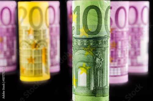 Tela  closeup view of 100 euro rolled banknote