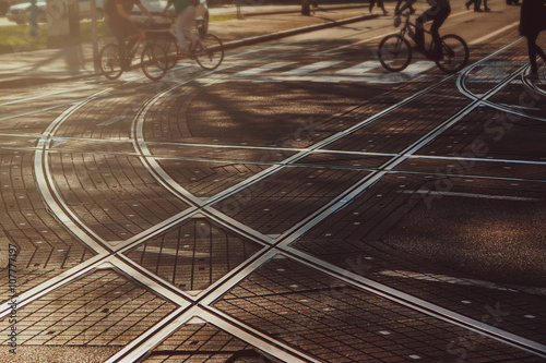 Fotografia  Tram lines intersection on the paved street in Zagreb, Croatia, intentionally bl