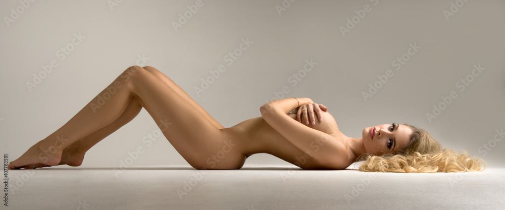 Fototapety, obrazy: Beautiful young naked blonde woman sitting over the background