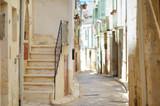 Fototapeta  - Typical medieval narrow street in beautiful town of Conversano