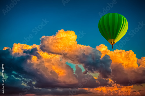 hot-air-balloon-with-cloudy-sunrise-background