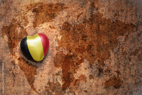 heart with national flag of belgium on a vintage world map crack ...