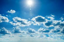 White Fluffy Clouds In The Blu...
