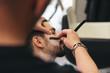 Bearded Man Getting Beard Haircut With A Razor By Barber