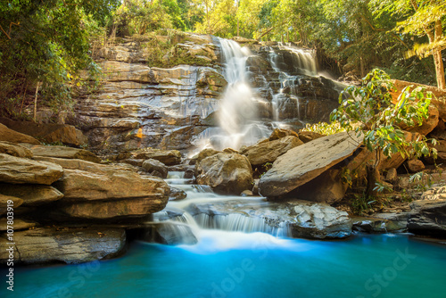 Foto op Canvas Watervallen beautiful waterfall in green forest in jungle Chiang mai , Thail
