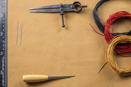 Divider wing, stitching awl and thread - Buy this stock