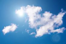 The Sun & Clouds On Blue Sky W...