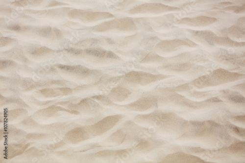 Photo Stands Stones in Sand Closeup photo of white sand