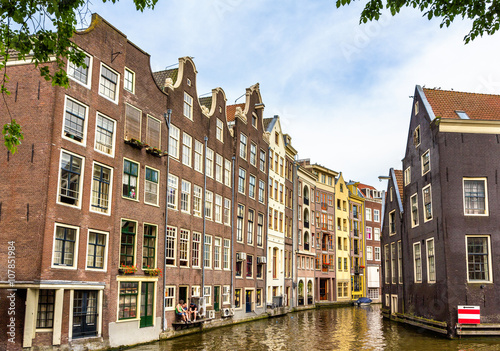 Photo  Houses in Damrak district of Amsterdam