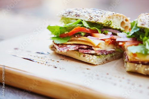 Staande foto Snack Fresh sandwich with cheese, lettuce, salami and tomato