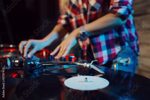 Cute dj woman having fun playing music at club party Wallpaper Mural