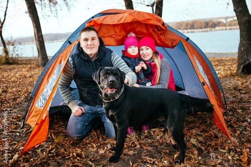 Camping in tent - family with dog camping in autumn forest - Buy