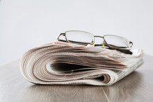Free Newspaper And Glasses On The Table