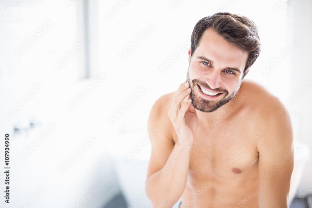 Fototapeta Man checking his stubble in bathroom