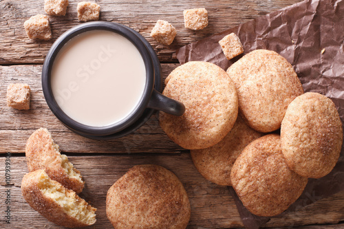 Tuinposter Koekjes cookies Snickerdoodle and coffee with milk close-up. horizontal top view