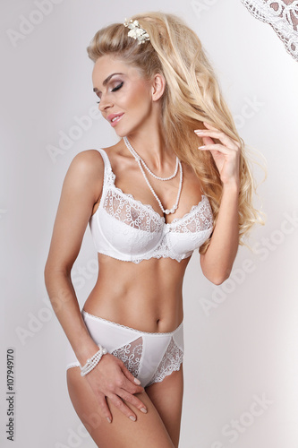 96911358cb4 Beautiful woman sexy blonde long hair green eyes in white erotic lace lingerie  white background