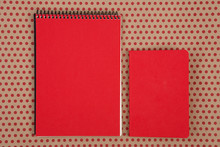 Desk Accessories - Two Red Notepads On Craft  Paper Background