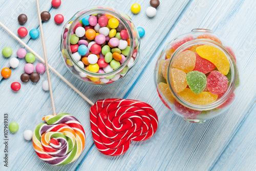 fototapeta na lodówkę Colorful candies on wooden table