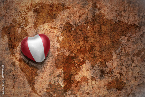 heart with national flag of peru on a vintage world map crack paper ...