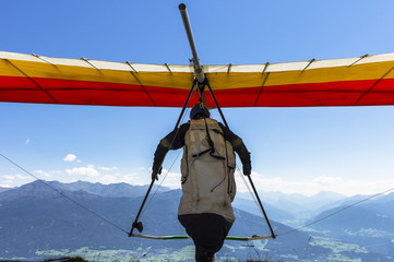 Fototapeta Hang glider take off in Austrian Alps.