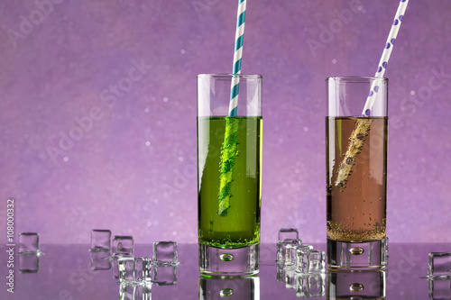 Set from two a collins glass with soda and colored straws