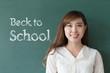 beautiful girl teacher with green blackboard